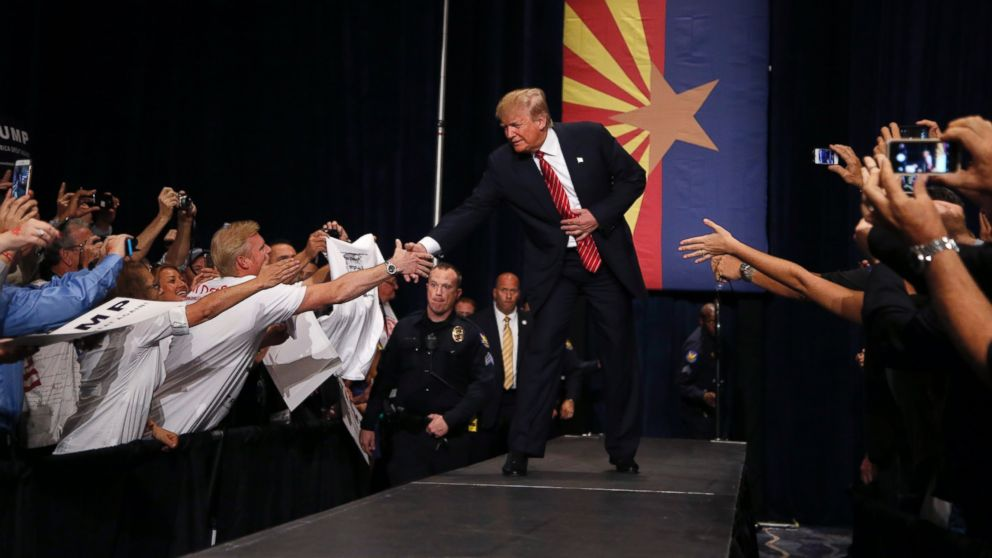 PHOTO: Republican presidential candidate Donald Trump shakes hands as he arrives to speak at a rally before a crowd of 3,500 Saturday, July 11, 2015, in Phoenix.