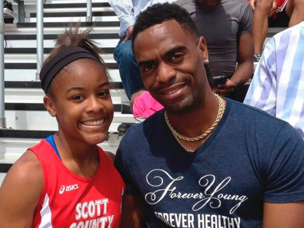 PHOTO: Trinity Gay poses for a photo with her father Tyson Gay.