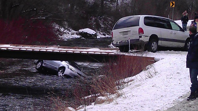 PHOTO: A photo provided by Chris Willden shows a car in the Logan River, Utah, after the car was flipped upright by rescuers who saved three children trapped in the car Dec. 31, 2011.
