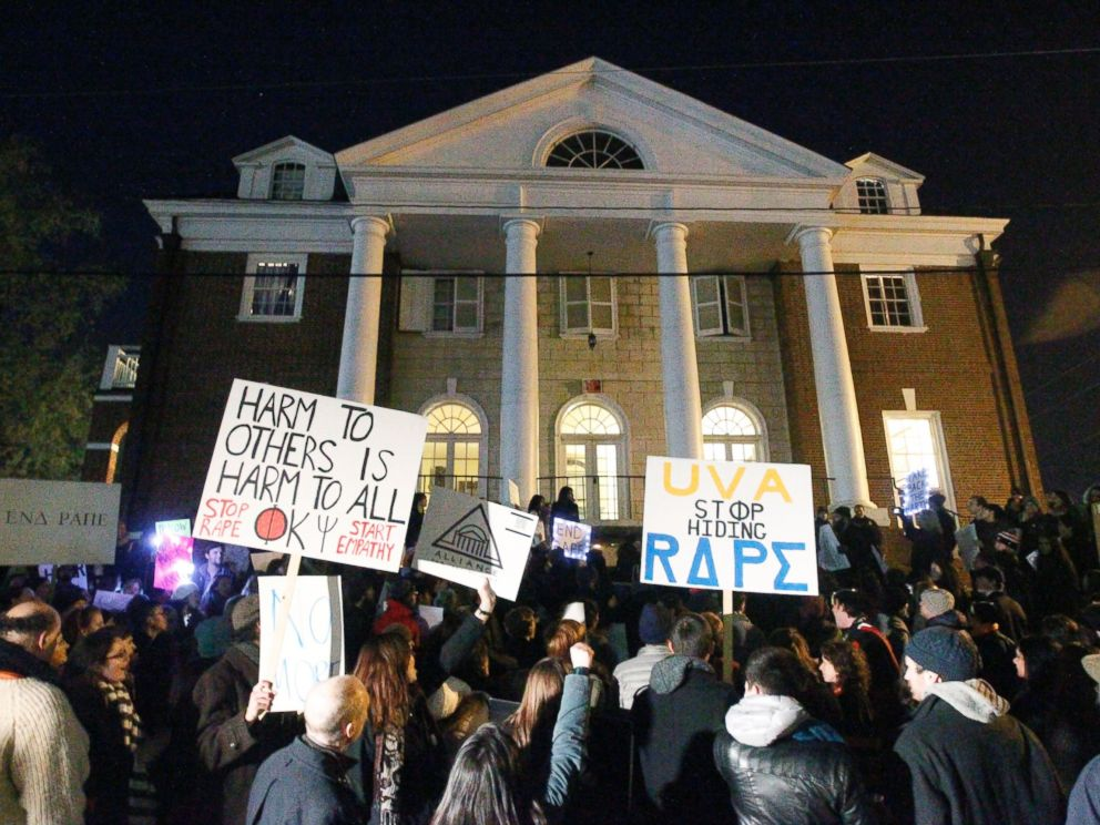 PHOTO: Protestors carry signs and chant slogans in front of the Phi Kappa Psi fraternity house at the University of Virginia, Nov. 22, 2014, in Charlottesville, Va.