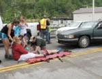 PHOTO: Emergency personnel respond to one of the people hit by a car, at right, during the beginning of the Hikers Parade at the Trail Days festival in Damascus, Va., Saturday, May 18, 2013.