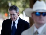 PHOTO: A law enforcement official stands by as Polygamist sect leader Warren Jeffs, left, arrives at the Tom Green County Courthouse on July 28, 2011, in San Angelo, Texas.