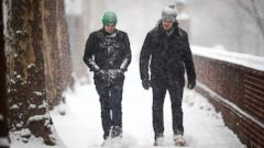 'PHOTO: Men walk along a snow cover sidewalk during a storm in Philadelphia, Friday, Dec. 15, 2017.' from the web at 'http://a.abcnews.com/images/US/ap_weather_dc_121617_16x9t_240.jpg'