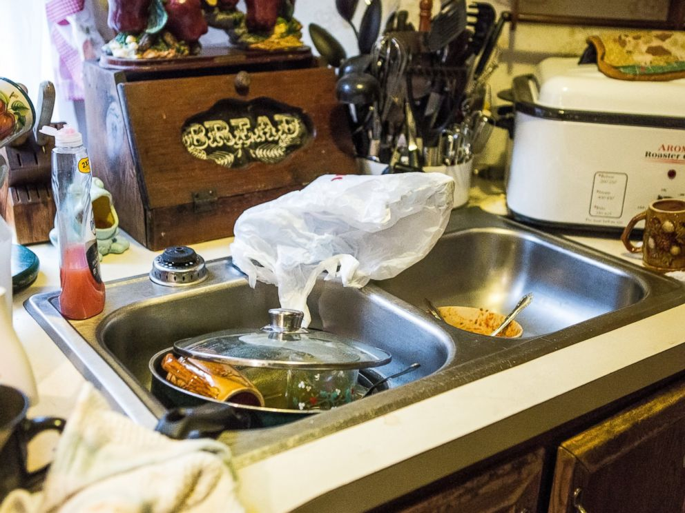 PHOTO: Bonnie Wireman of Dry Branch, W.Va has covered her kitchen faucets in a bag because she kept forgetting about the ban on using tap water for drinking and washing.