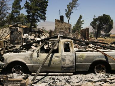Photos:  Western Wildfires Destroy Homes, Force Evacuations