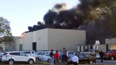 PHOTO: In the image from video provided by KAKE News black smoke billows from a building at Mid-Continent Airport where officials say a plane crashed, Oct. 30, 2014 in Wichita, Kan.