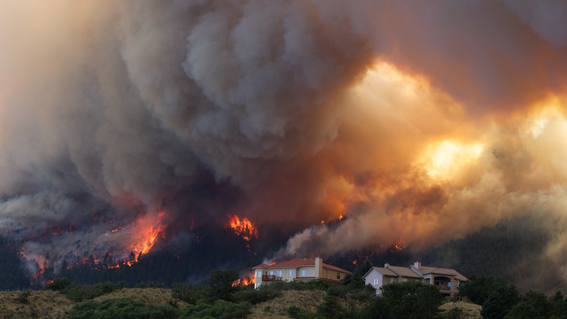 PHOTO: Fire from the Waldo Canyon wildfire burns as it moved into subdivisions and destroyed homes in Colorado Springs, Colo., June 26, 2012.