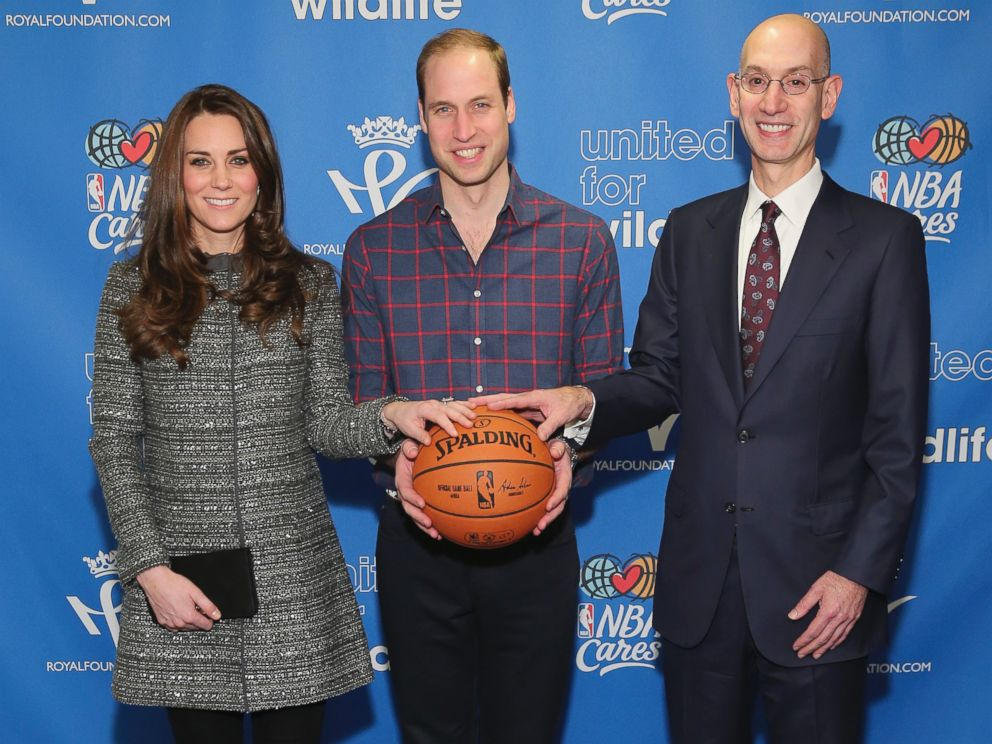 PHOTO: Prince William, the Duke of Cambridge, and Catherine, Duchess of Cambridge, pose for a photo with NBA Commissioner Adam Silver while attending a basketball game, Dec. 8, 2014 in New York.