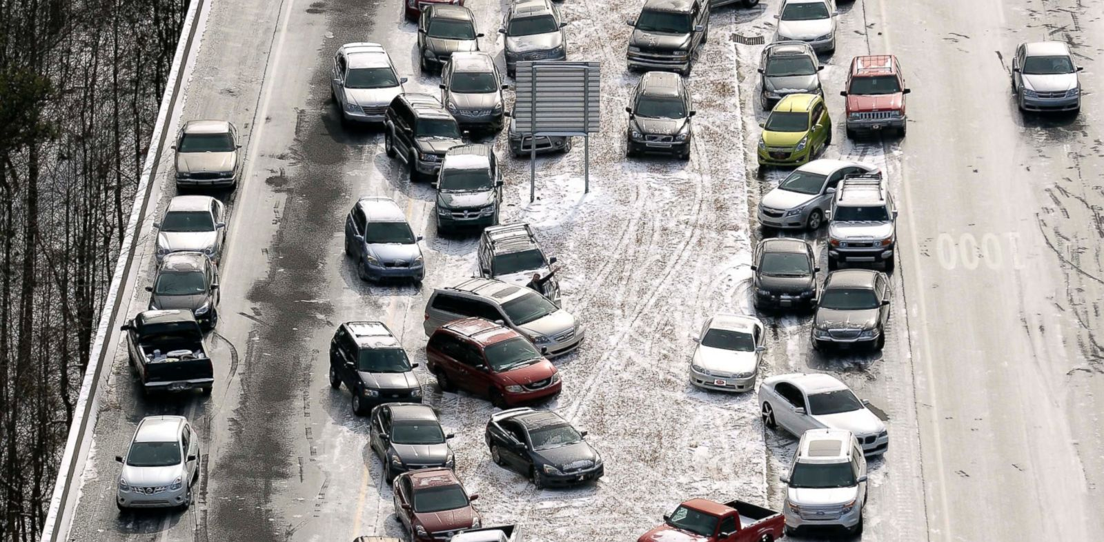 PHOTO: In this aerial photo, abandoned cars at I-75 headed northbound near the Chattahoochee River overpass are piled up in the median of the ice-covered interstate after a winter snow storm on Jan. 29, 2014, in Atlanta.