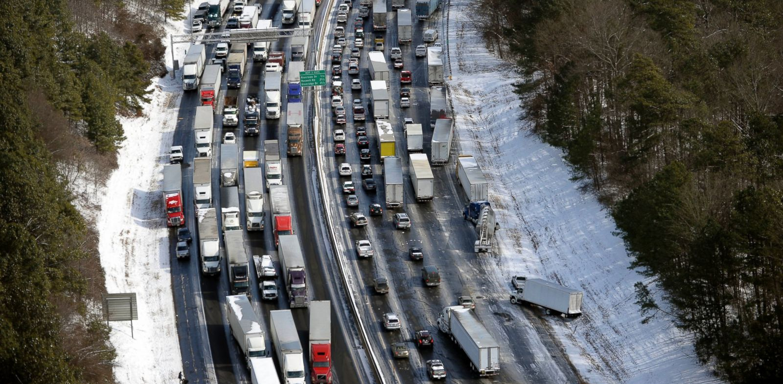 PHOTO: In this aerial photo, traffic is snarled along the I-285 perimeter north of the metro area after a winter snow storm on Jan. 29, 2014, in Atlanta.