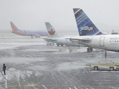 PHOTO: A girl watches activity at LaGuardia Airport in New York, Jan. 26, 2015.