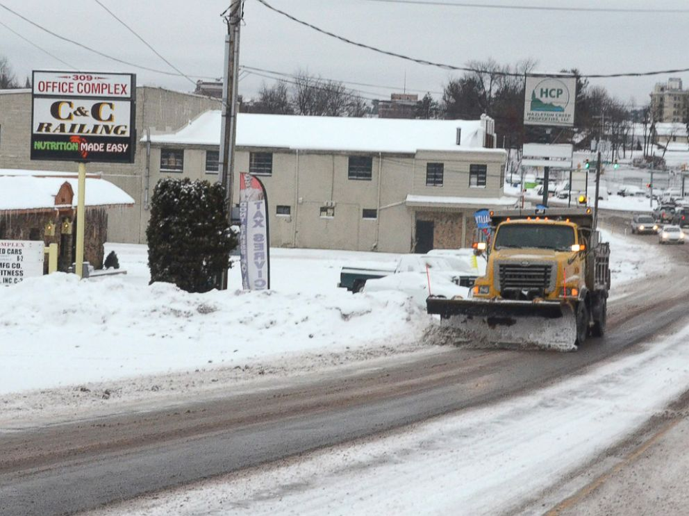 PHOTO: A driver of a PennDOT plow truck clears snow off of South Church Street, in Hazleton Pa., Jan. 26, 2015.