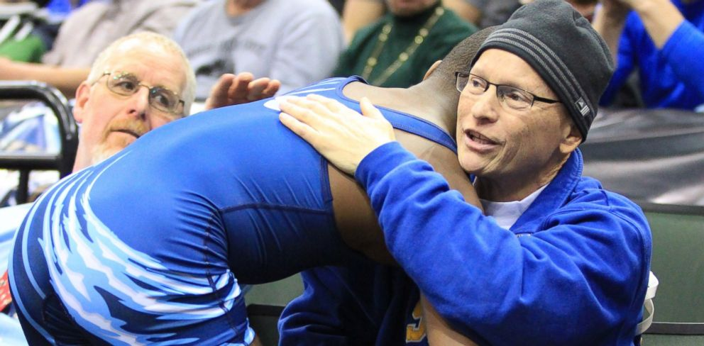 PHOTO: In this March 1, 2014 photo provided by Vanessa Schlueter, Minnesota wrestler Malik Stewart hugs Steve McKee moments after losing high school wrestling title match to McKees son, Mitchell, in St. Paul, Minn.