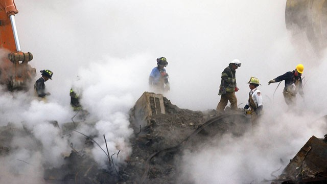 PHOTO:&nbsp;In this Oct. 11, 2001 file photo, firefighters make their way over the ruins and through clouds of smoke at the World Trade Center in New York.