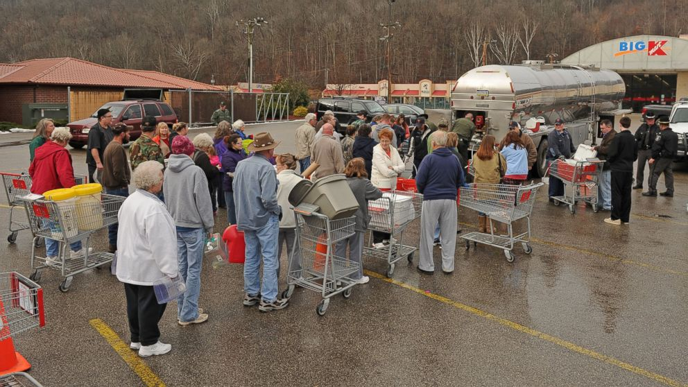 PHOTO: West Virginia State Troopers fill water jugs at the Kmart in Elkview, W.Va. on Jan. 10, 2014 as emergency crews are setting up water depots following a chemical spill on the Elk River that compromised the public water supply to nine counties.
