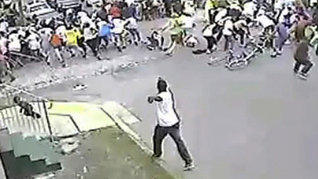 PHOTO: In this image taken from video and provided on May 13, 2013, a possible shooting suspect in a white shirt, bottom center, shoots into a crowd of people, on May 12, 2013 in New Orleans.