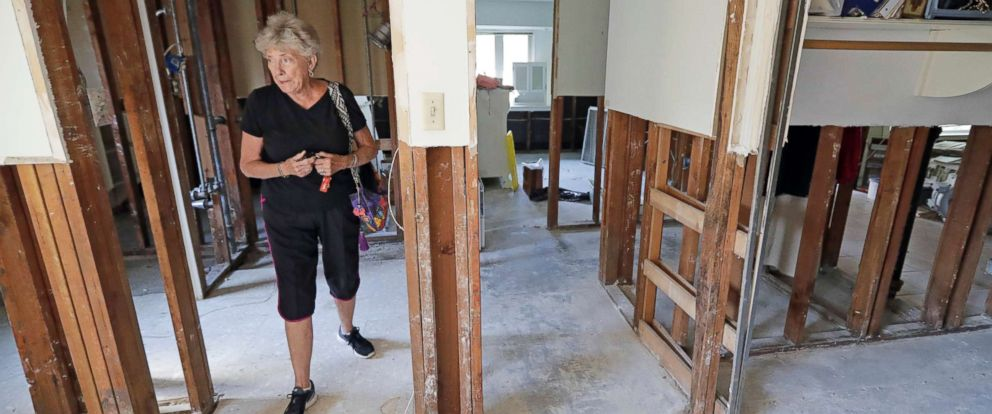 PHOTO: Arlene Estle looks at the damage to her home which was flooded in the aftermath of Hurricane Harvey, in Houston.