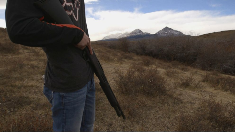 PHOTO: A volunteer carries a shotgun as protection against wildlife on a recent mountain search for Ashley Loring HeavyRunner.