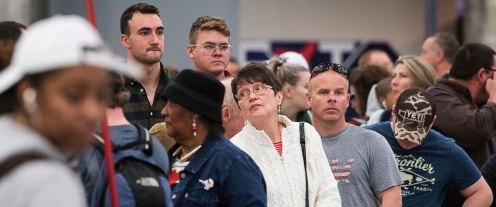 PHOTO: People wait in line to re-book their flights at Hartfield-Jackson Atlanta International Airport, Dec. 18, 2017, in Atlanta.