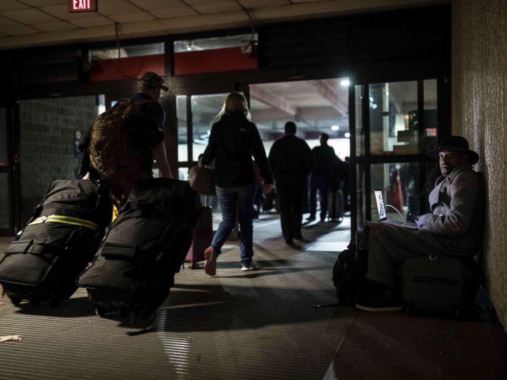 PHOTO: A traveler waits in dark at Hartfield-Jackson Atlanta International Airport, Dec. 17, 2017, in Atlanta.