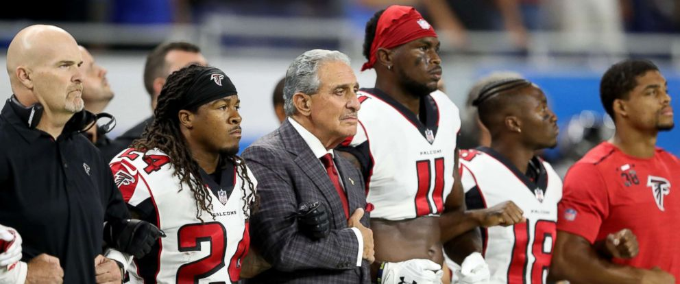 PHOTO: Atlanta Falcons owner Arthur Blank joins arms with his players during the playing of the national anthem prior to the game against the Detroit Lions at Ford Field, Sept. 24, 2017 in Detroit, Mich.