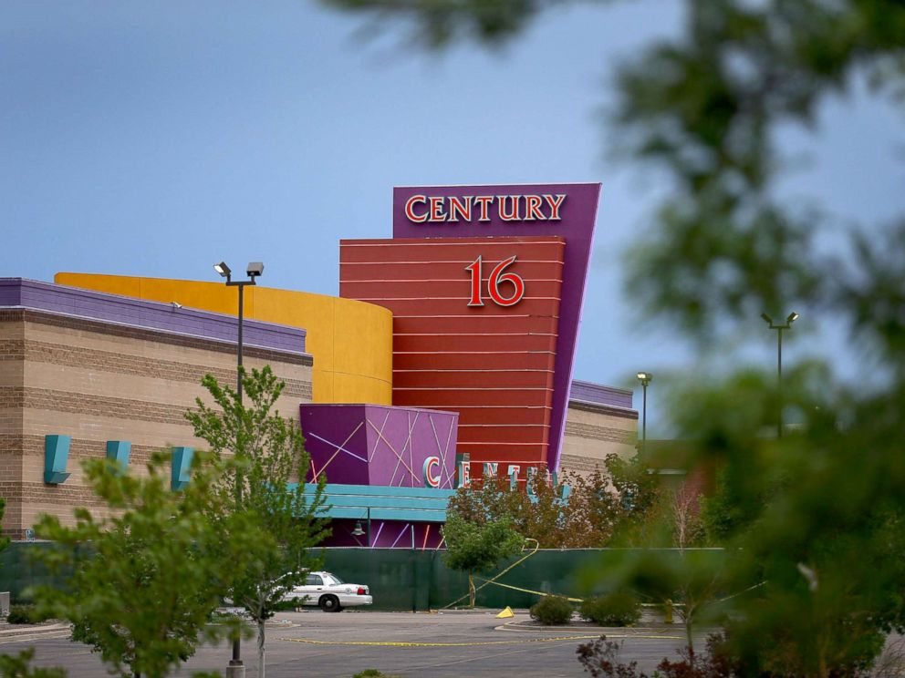 PHOTO: The Century 16 movie theatre is seen from a memorial setup across the street, July 28, 2012 in Aurora, Colorado.