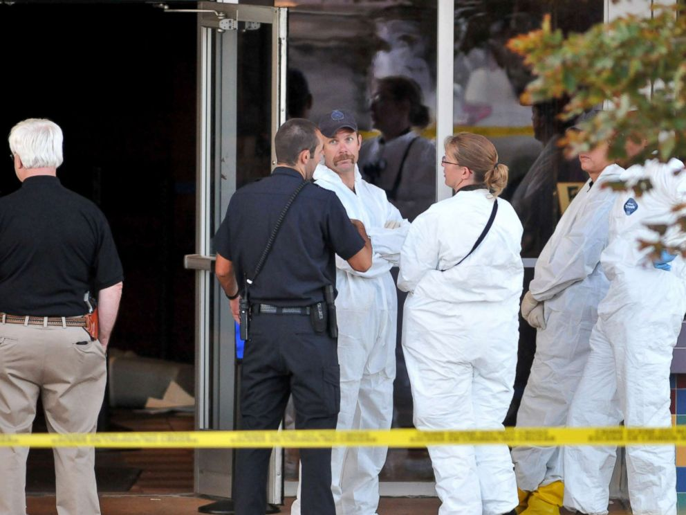 PHOTO: Investigators are on the scene at the Century 16 movie theatre where a gunmen attacked movie goers during an early morning screening of The Dark Knight Rises, July 20, 2012, in Aurora, Colorado.