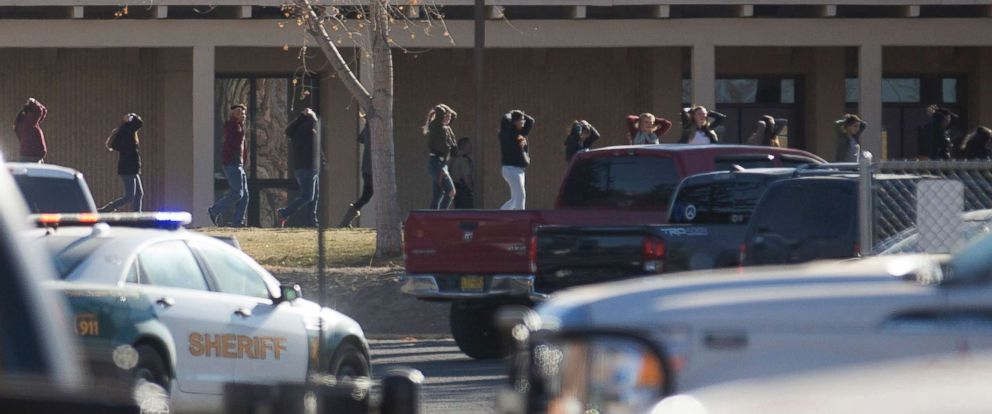 PHOTO: Students are led away from their classrooms following a school shooting at Aztec High School in Aztec, N.M., Dec. 7, 2017.