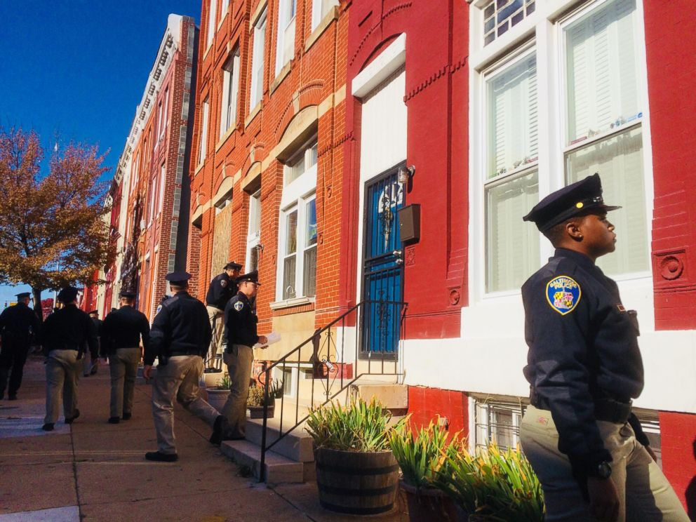 PHOTO: Baltimore police academy personnel canvass the area while detectives continue gathering evidence near the location where a police officer was shot, Nov. 16, 2017.