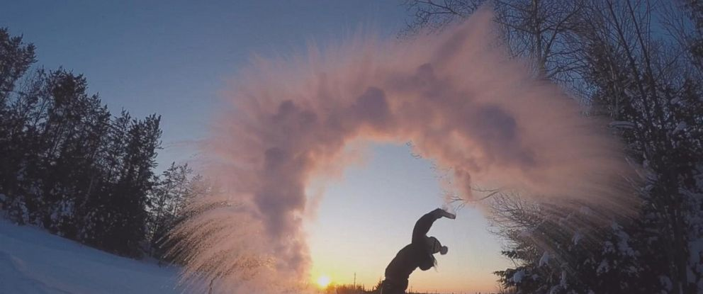 PHOTO: To display just how cold it actually was, Kerrilyn Esselink, of the Manitou Weather Station Fishing Lodge, threw a mug full of water over her head against the setting sun. The water froze instantly as it was lifted upwards by the wind