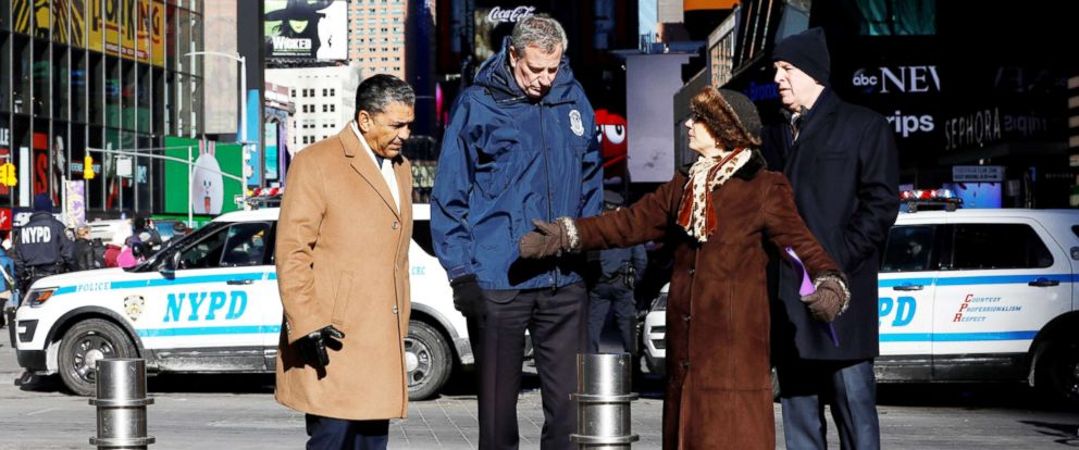 PHOTO: U.S. Congressman Adriano Espaillat, New York City Mayor Bill de Blasio, NYC Department of Transportation Commissioner Polly Trottenberg, NYPD Commissioner James ONeill stand near bollards in Times Square, New York City, Jan. 02, 2018.