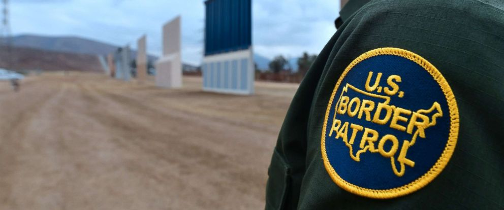 PHOTO: A U.S. Border Patrol officer stands near prototypes of US President Donald Trumps proposed border wall, Nov. 1, 2017, in San Diego, Calif.