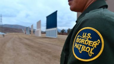 'PHOTO: A U.S. Border Patrol officer stands near prototypes of US President Donald Trump's proposed border wall, Nov. 1, 2017, in San Diego, Calif.' from the web at 'http://a.abcnews.com/images/US/border-gty-ml-172011_16x9t_384.jpg'