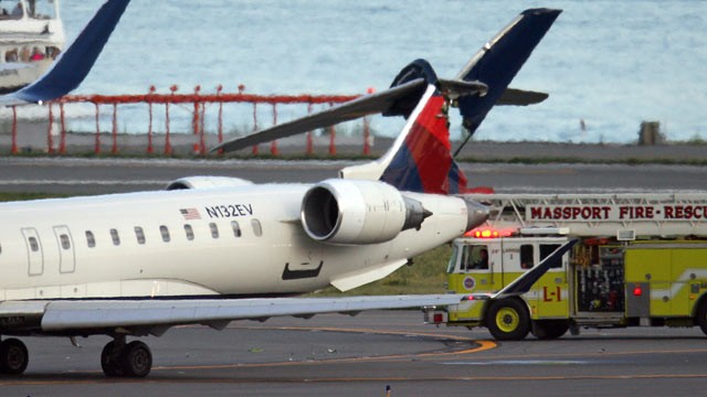 PHOTO: Two planes clipped each other while taxiing at Boston Logan International Airport, possibly injuring one person.