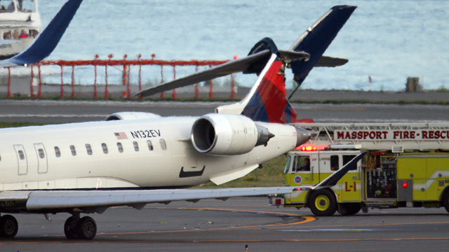 PHOTO:Two planes clipped each other while taxiing at Boston Logan International Airport, possibly injuring one person.