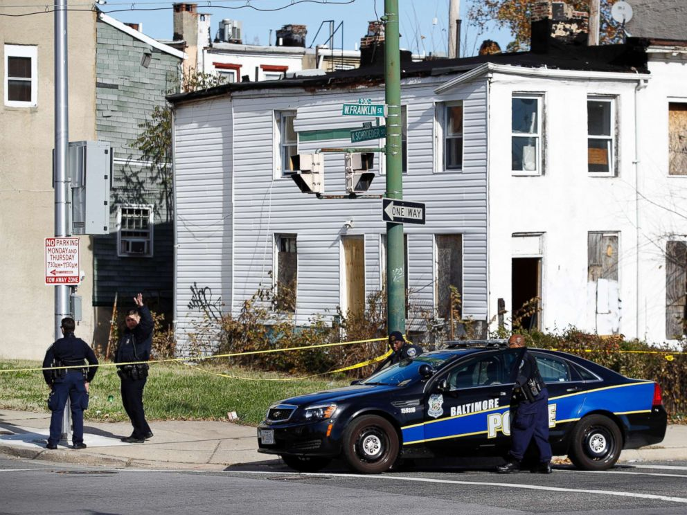 PHOTO:Members of the Baltimore Police Department gather near the scene of the shooting death of Baltimore Police detective Sean Suiter in Baltimore, Nov. 17, 2017.