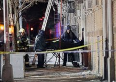 'PHOTO: Emergency workers remove a body from the site of an apartment fire in the Bronx, New York, Dec. 29, 2017.' from the web at 'http://a.abcnews.com/images/US/bronx-fire-body-removal-nc-ps-171229_17x12_240.jpg'