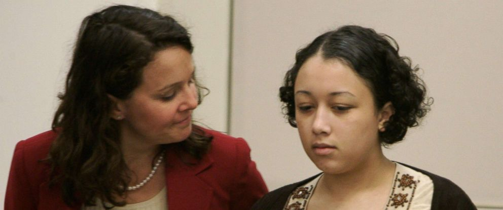PHOTO: Wendy Tucker rubs Cyntoia Browns back during closing arguments in her trial in Nashville, Tenn. Brown received a life sentence for the murder of Johnny Mitchell Allen, Aug. 25, 2006.