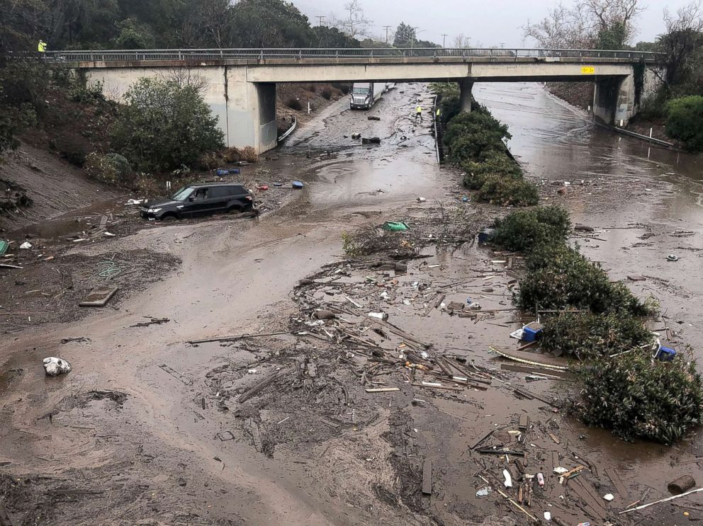 PHOTO: US 101 Freeway at the Olive Mill Road overpass flooded with runoff water from Montecito Creek and blocked with mudflow and debris following heavy rains in Montecito, Calif., Jan. 9, 2018.