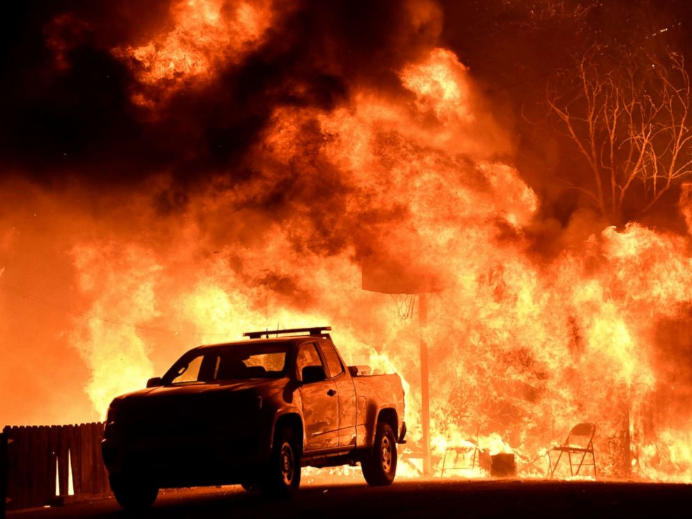 PHOTO: Flames spread behind a vehicle from a Santa Ana wind-driven brush fire called the Thomas Fire in Santa Paula, Calif., Dec. 4, 2017.