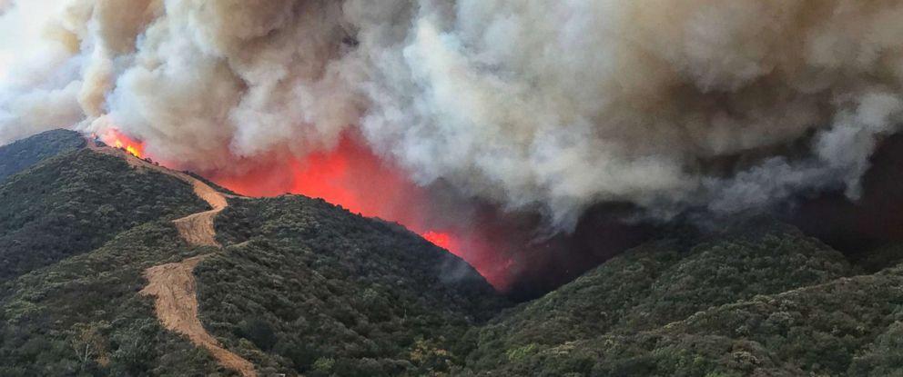PHOTO: Flames churn towards a large fire break near homes along Gibraltar Road north of Santa Barbara, Calif., Dec. 16, 2017.