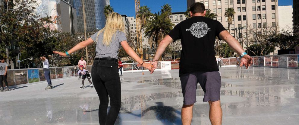 PHOTO: A couple maneuvers their way around the Holiday Ice Rink in Pershing Square in downtown Los Angeles on Nov. 22, 2017.