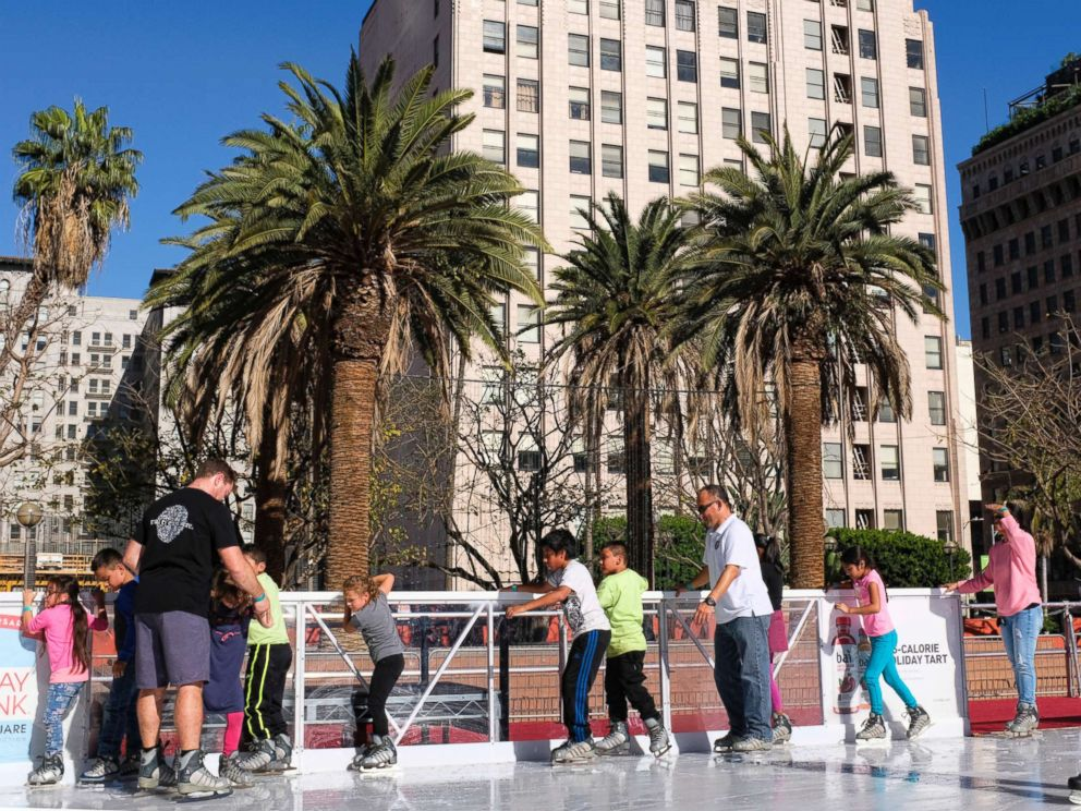 PHOTO: Schoolchildren carefully maneuver their way around the Holiday Ice Rink in Pershing Square in downtown Los Angeles on Nov. 22, 2017.