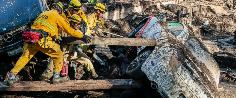PHOTO: Rescue workers search in an around cars for missing persons after a mudslide in Montecito, Calif., Jan. 12, 2018.