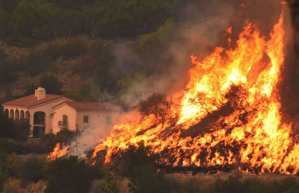 PHOTO: This undated photo obtained from the Santa Barbara County Fire, shows flames from the Thomas Fire near homes.