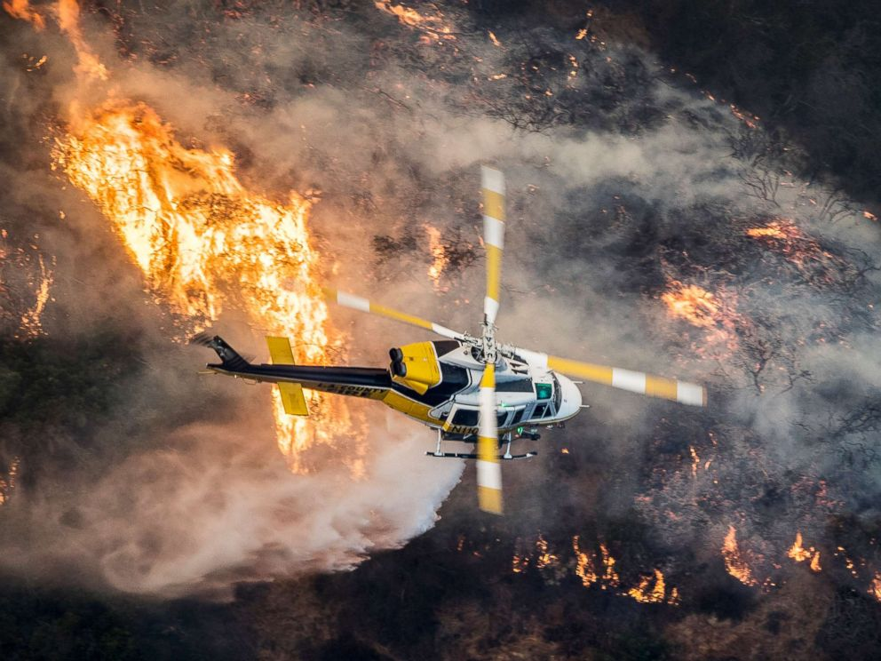 Fast-moving wildfires raging in Southern California threaten thousands of homes