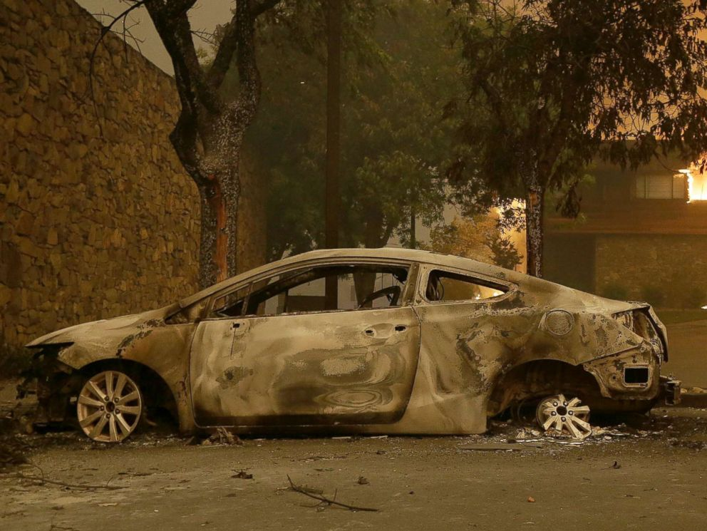 PHOTO: The remains of a car sits near the Fountaingrove Inn Hotel as it burns at rear in Santa Rosa, Calif., Oct. 9, 2017.