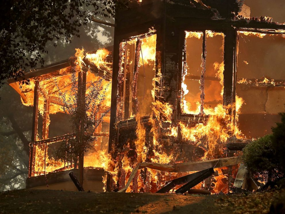 PHOTO: Flames consume a home as an out of control wildfire moves through the area, Oct. 9, 2017, in Glen Ellen, California.
