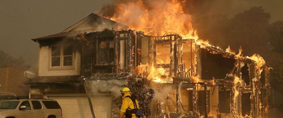 PHOTO: A firefighters walks near a home in Santa Rosa, Calif., Oct. 9, 2017.