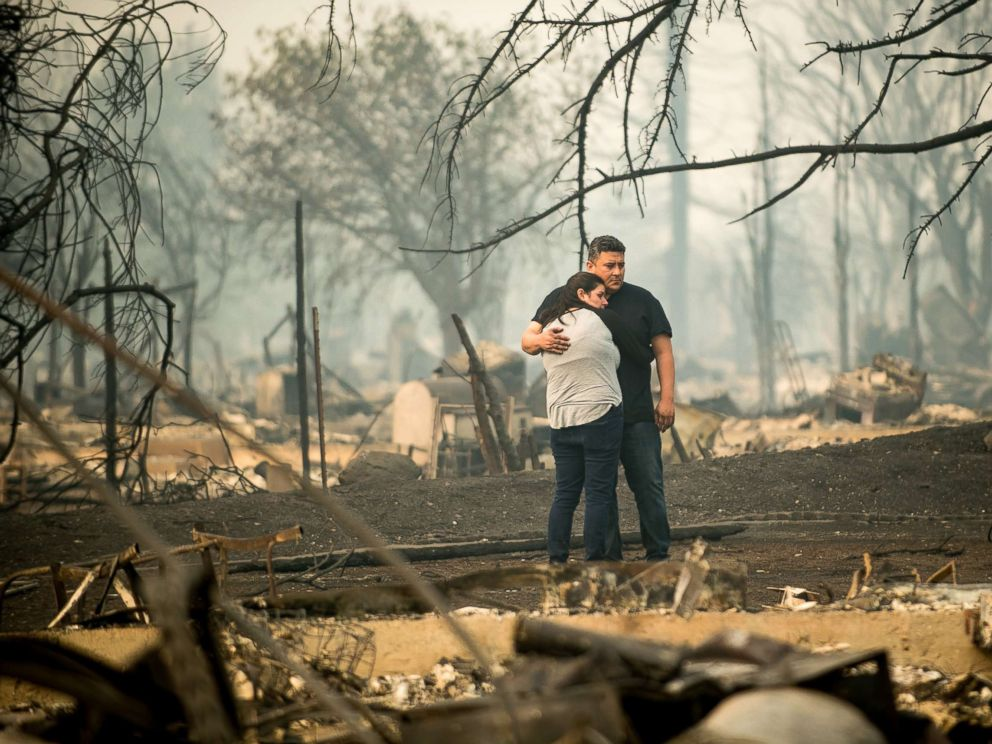PHOTO: Gabriel Castillo and wife Alea Kelleher embrace while sifting through the remains of their home in Santa Rosa, Calif., Oct. 10, 2017.
